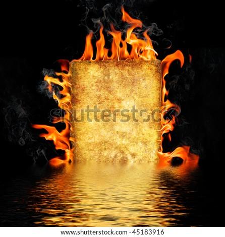 Burning paper on black background - stock photo