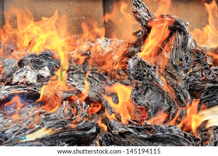 burning paper with fire - stock photo