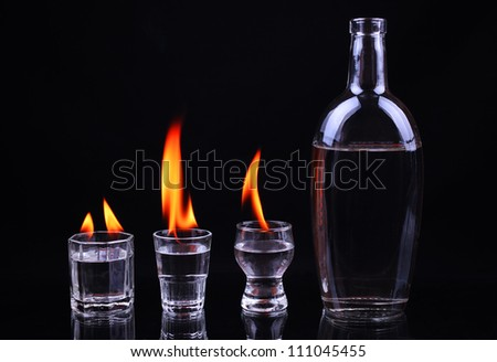 Burning piles of tequila and a bottle - stock photo