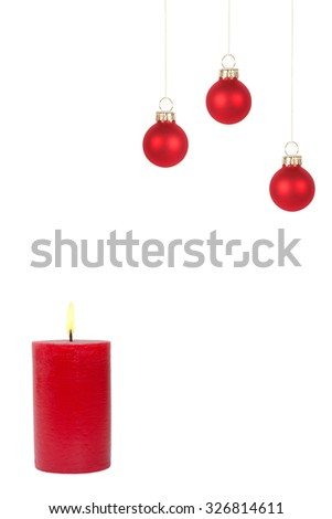 Burning red candle and three christmas tree balls in front of white background - stock photo