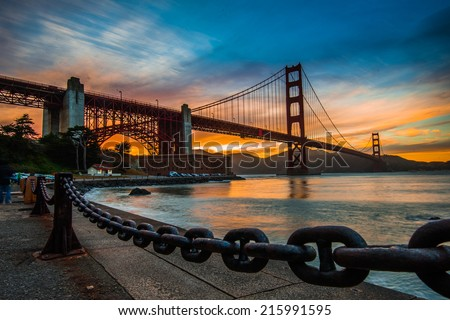 burning sky over Golden gate Bridge - stock photo