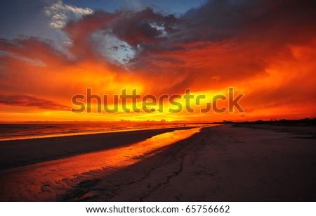 Burning sky over Honeymoon Island State Park - stock photo