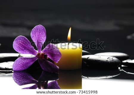 burning spa candles with pink orchid and stones reflection - stock photo