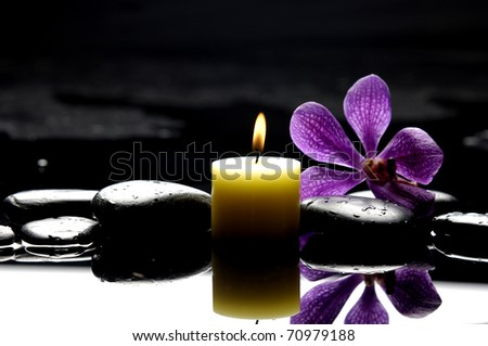 burning spa candles with pink orchid reflection - stock photo
