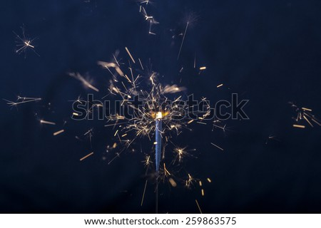 Burning Sparkler. Image with shallow depth of field - stock photo