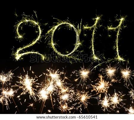 burning sparkler on New Years Eve - stock photo