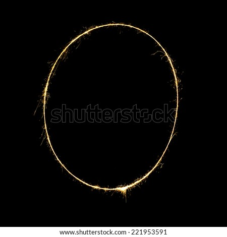 burning sparkler stick and writing sparkling text . number zero  isolated on black background - stock photo