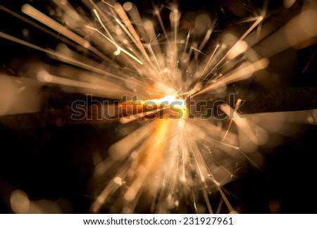 Burning sparklers isolated on black background - stock photo