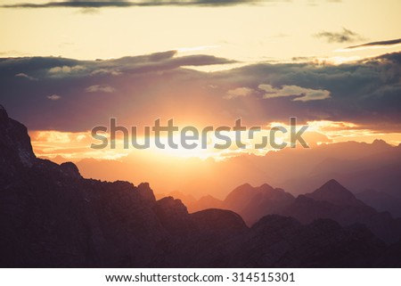 Burning sunset as viewed from the mountain Mojstrovka in Julian alps. Dramatic and picturesque sunset.