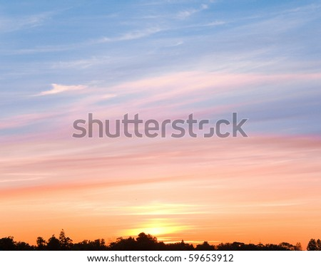 Burning Sunset Cloudscape - stock photo