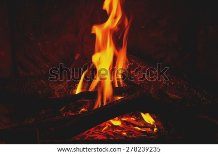 burning wood, fire and flames in the fireplace - stock photo