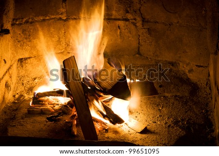 burning wood in a fireplace close up - stock photo