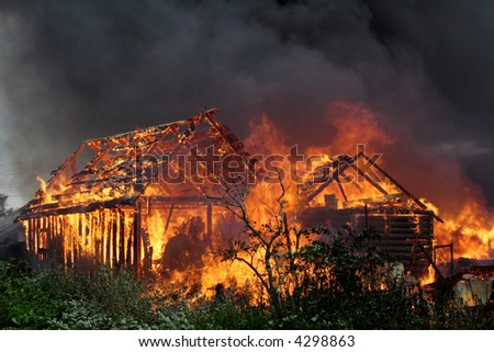 Burning wooden house - stock photo