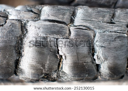 Burnt cracked wood texture. resource, charcoal, raw - stock photo