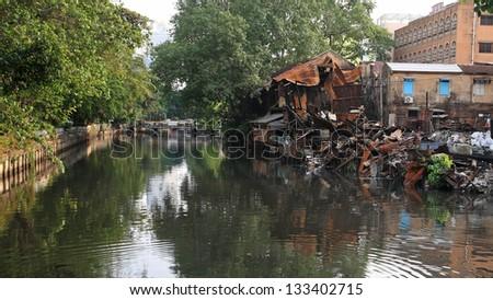 Burnt house near the canal - stock photo