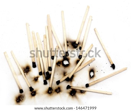 burnt matches on a white background - stock photo
