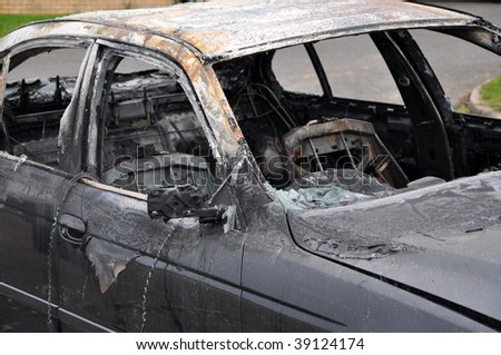 Burnt out car - stock photo