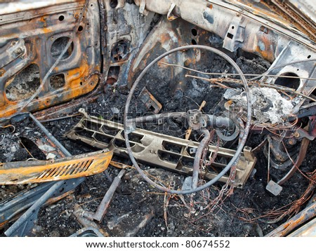 Burnt out car interior - stock photo