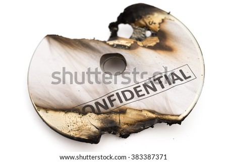 burnt out confidential cd on white with clipping path - stock photo