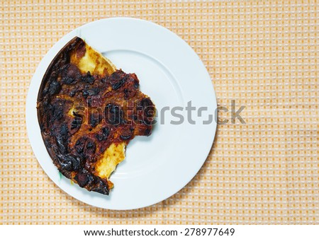 Burnt pizza - stock photo