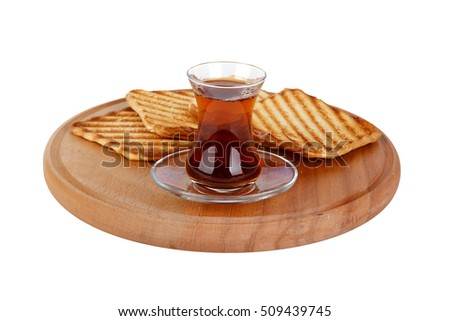 Burnt toasted bread and tea on wooden board, isolated on white background.
