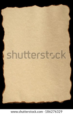 Burnt vintage paper on black background - stock photo