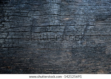 Burnt wood texture - stock photo