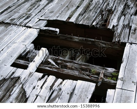 Burnt Wooden Timbers on Pier Planks over water