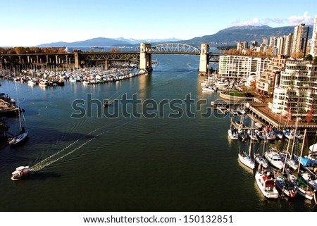 Burrard Bridge and Vancouver False Creek with Yaletown Marina from Cambie, ferries - stock photo