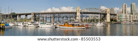 Burrard Street Bridge by Fishermen's Wharf in Vancouver BC Canada Panorama - stock photo