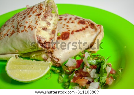 Burrito on green plate