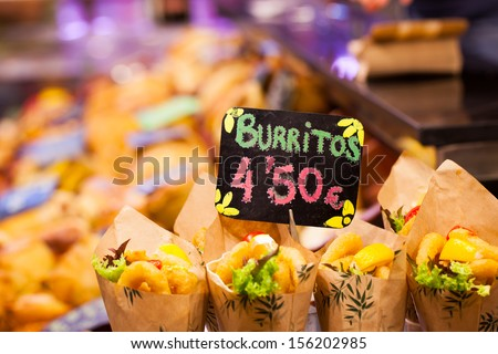 Burrito stall in a indoors market.  - stock photo