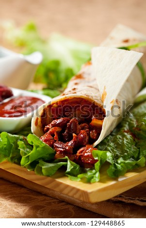 Burrito with Beef and Fresh Salad Leaves