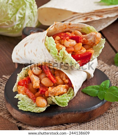 Burrito with chicken, beans, tomatoes and sweet peppers - stock photo
