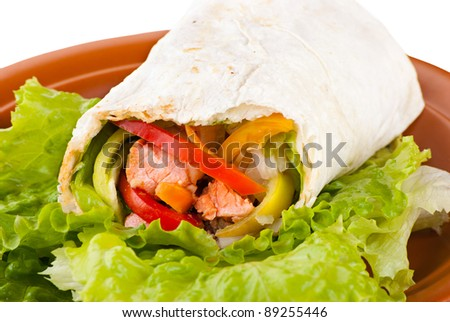 burrito with salmon, yellow, green and red peppers and tomato on plate - stock photo