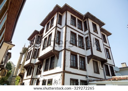 Bursa, Turkey - April 17, 2015: Wooden based Ottoman style architecture in a street in Tophane district of Bursa old town, Marmara, Turkey on April 17, 2015 - stock photo