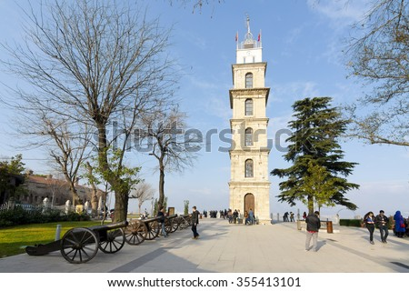 Bursa, Turkey - December 26, 2015:  People are visiting historical clock tower in Tophane district of Bursa city, - stock photo