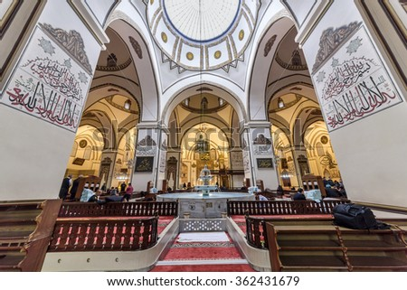 BURSA, TURKEY - JANUARY 13: An interior view of Great Mosque (Ulu Cami) on January 13, 2016 in Bursa, Turkey. Great Mosque is the largest mosque in Bursa. Muslims who pray in the mosque. - stock photo