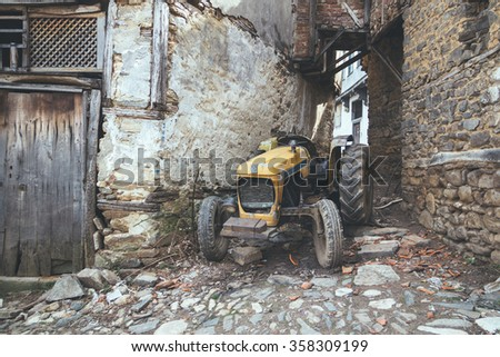 Bursa, Turkey-March 6, 2015: An old tractor parked in the streets of Cumalizik in Bursa. Cumalikizik is an old village with history dating back to the Ottoman Empire's foundation period.  - stock photo