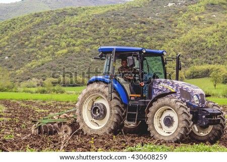 Bursa, Turkey - May 2, 2016: Unidentified young Turkish farmer working at agricultural fields of Yenisehir Ovasi, Burcun Village in Bursa Province.
