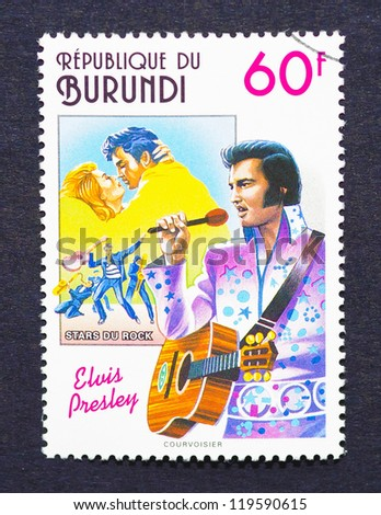 BURUNDI - CIRCA 1994: a postage stamp printed in Burundi showing an image of Elvis Presley, circa 1994. - stock photo