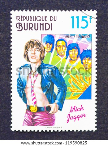 BURUNDI - CIRCA 1994: a postage stamp printed in Burundi showing an image of Mick Jagger and The Rolling Stones, circa 1994. - stock photo