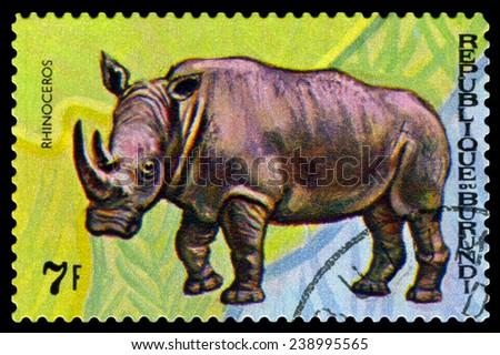 BURUNDI - CIRCA 1970 : A stamp printed by Burundi shows Animals Burundi, Rhinoseros, map Burundi, circa 1970. - stock photo
