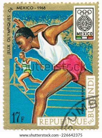 BURUNDI - CIRCA 1968: A stamp printed in Burundi shows runner at the finish, series 19th Olympic Games, Mexico City, circa 1968