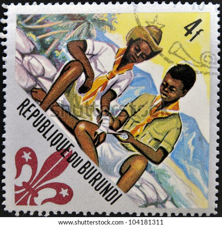 BURUNDI - CIRCA 1967: A stamp printed in Burundi shows two boy scouts, circa 1967 - stock photo
