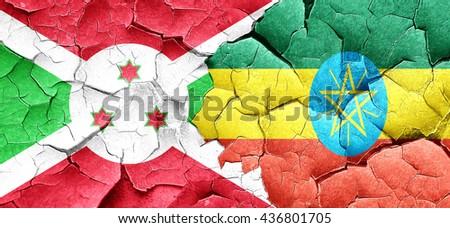 Burundi flag with Ethiopia flag on a grunge cracked wall - stock photo