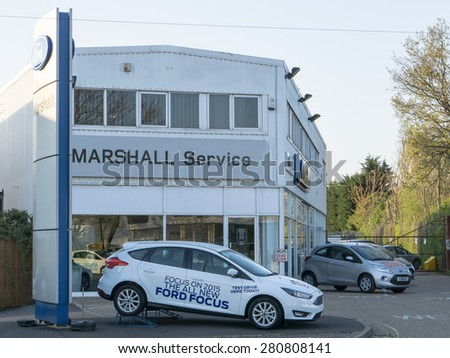 BURY ST EDMUNDS, ENGLAND - 23 APRIL 2015: Marshall Ford dealership. Ford is US-based automaker and the one of the largest in the world based on annual vehicle sales England, UK - stock photo