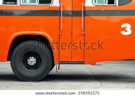 Bus, Autobus, School bus side view, wing with a wheel, Orange bus. - stock photo