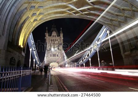 Bus cross the Tower Bridge by night - stock photo