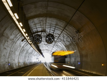 Bus driving in Tunnel de la Croix-Rousse, a tunnel for public transport, cyclist and pedestrians in Lyon, France. - stock photo